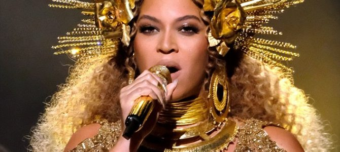 You can see her halo! Beyoncé wows at the Grammys with a gilded beauty look created with DRUGSTORE products
